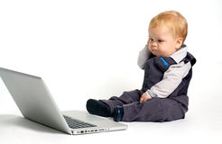Baby thinking laptop royalty free stock photography