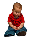 Baby thinks. A young baby boy worried and thinking as he looks down, isolated on white royalty free stock image