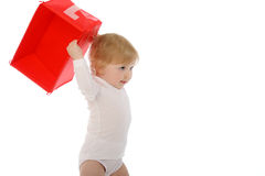 Baby throwing red box isolated on white Royalty Free Stock Image