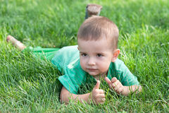 Baby with thumbs up Stock Photo