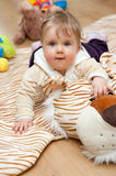 Baby on tiger mat Royalty Free Stock Photo