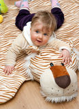Baby on tiger mat Royalty Free Stock Image