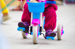 Baby on a tiny bike Royalty Free Stock Images