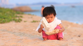 Baby to play on the beach Stock Photography