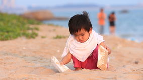 Baby to play on the beach stock video