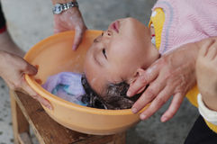 Baby to shampoo. Baby have a shampoo by mother Stock Image