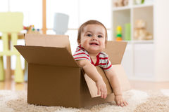 Baby toddler in a carton box Royalty Free Stock Image