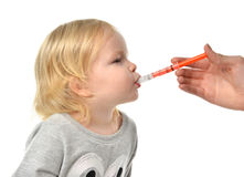 Baby toddler child take an oral medical suspension an ibuprofen Stock Photography