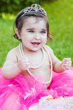 Baby toddler girl in first birthday anniversary party Stock Photos