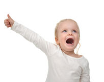 Baby toddler happy looking up yelling screaming with hand thumb Stock Images