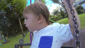 Baby Toddler in the Park Swing 02 stock video footage
