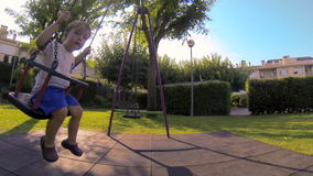 Baby Toddler in the Park Swing 01 stock footage