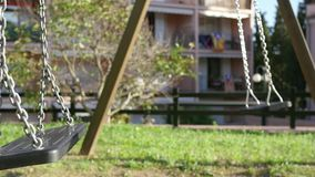 Baby Toddler Playing with the Park Swings stock footage