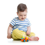 Baby toddler playing with toy car Royalty Free Stock Images