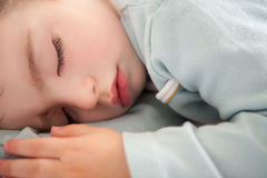 Baby toddler sleeping closed eyes relaxed. In soft blue royalty free stock images
