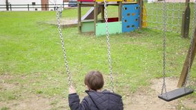 Baby Toddler Swinging on the Park Swing stock footage