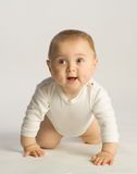 Baby toddling. Boy with diaper scrambling ahead Stock Photos