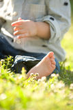 Baby Toes. Child's barefoot toes in the grass on a sunny day at the park Royalty Free Stock Image