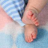 Baby toes. Photo of curled baby toes Royalty Free Stock Photo