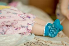 Baby toes in a little blue socks. Baby toes in a little blue socks Royalty Free Stock Images