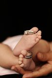 Baby Toes With Wedding Rings Royalty Free Stock Photography