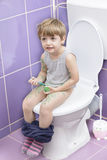 Baby on the Toilet. Cute baby on toilet drawing himself Stock Images