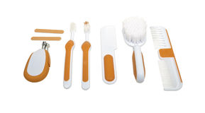 Baby Toiletry Items. Including clipper, brush, comb, and dental items - path included Royalty Free Stock Photos