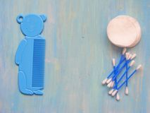 Baby Toiletry Items on blue wooden background with copy space. Baby Toiletry Items on blue wooden background Royalty Free Stock Photos