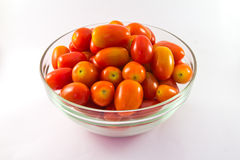 Baby tomatoes in glass bowl Stock Photography
