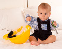 Baby and tools Stock Images