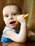 Baby with toothbrush Royalty Free Stock Photography