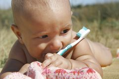 Baby with toothbrush. Portrait of a baby with toothbrush Stock Photo