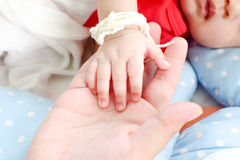 Baby touch mother hand. New born baby put her hand on mother hand Royalty Free Stock Photos