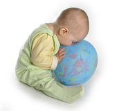 Baby touch nose to balloon. On white stock photo