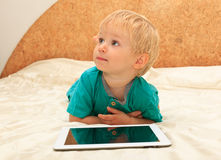 Baby with touch pad at home Stock Images