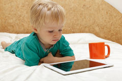 Baby with touch pad at home Royalty Free Stock Image