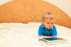 Baby with touch pad at home Stock Photos