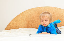Baby with touch pad at home Royalty Free Stock Images
