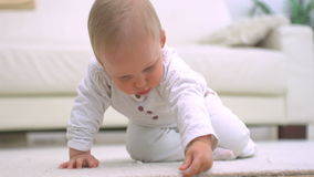 Baby touching a carpet Royalty Free Stock Photography