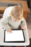 Baby touching screen tablet Royalty Free Stock Image
