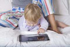 Baby touching tablet Royalty Free Stock Images