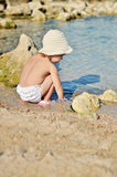 Baby is touching water Royalty Free Stock Photo