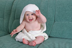 Baby with towel. Smile baby boy with towel stock image