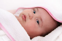 Baby with towel Stock Photography