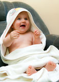 Baby in towel after bath Royalty Free Stock Photos