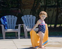 Baby with towel after bathing Stock Photos