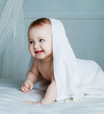Baby with a towel Royalty Free Stock Image
