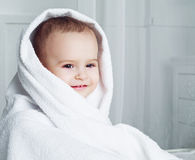 Baby with a towel Stock Photos