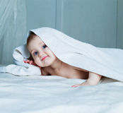 Baby with a towel Royalty Free Stock Photo