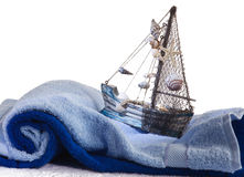 Baby towel and a toy ship Stock Photo